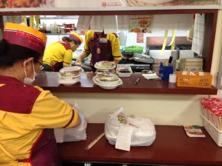There's usually only one employee in the front of the store; food preparation takes place in the busy kitchen behind the sales counter