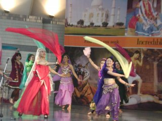 Dancers swirling colorful scarves