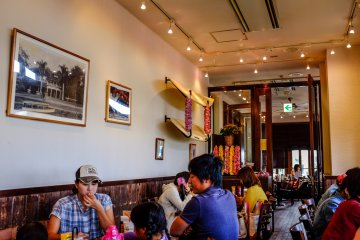 <p>The restaurant is filled with Hawaiian paraphranalia like surfboards, lei necklaces and surfing photos</p>