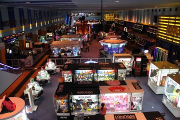 <p>The cavernous arcade on the first floor is full of skill cranes, photo booths, video games and other skill games</p>