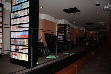 <p>The fourth floor comic and relaxation area features massage chairs and manga books all overlooking the bowling alley on the third floor</p>