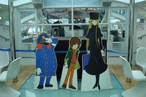 Cutouts of Matsumoto's Galaxy Express 999 characters aboard Himiko.