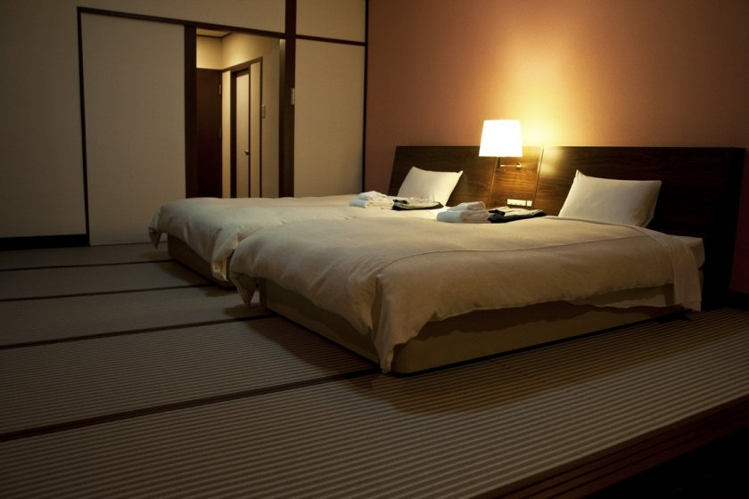The guestrooms feature tatami flooring with western bedding.