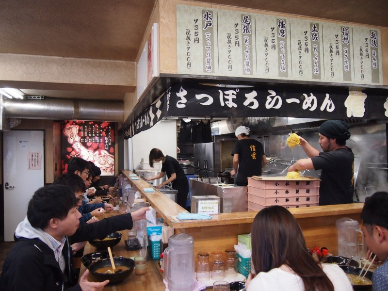 The bar counter, over which piping bowls of ramen are served.