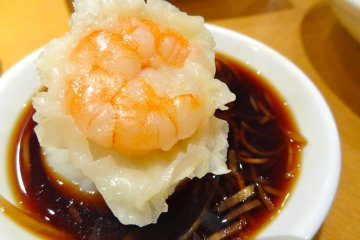 Dipping the Shrimp & Pork Shao-Mai into the ginger sauce