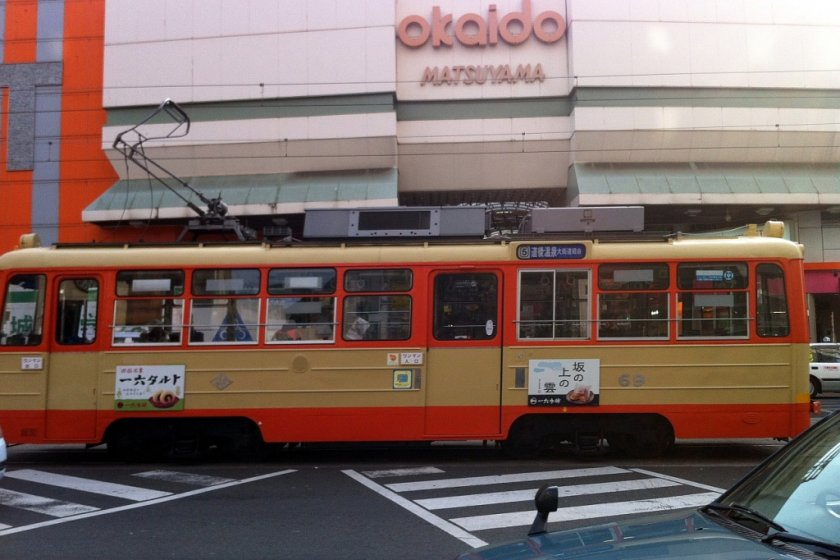 A tram rattles out from the Okaido stop