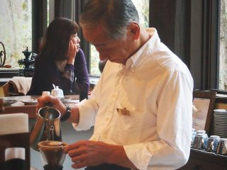 The barista will then gently pour scalding water over the grounded coffee powder to create a delicious drip coffee.