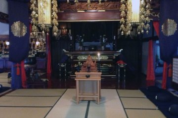 <p>The meditation and prayer room. As an almost insult to the beautiful central decorations, meditation is done by staring at a wall only an arm&#39;s length in front of you.</p>