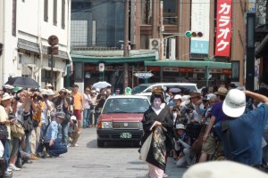 Cabs will still drive through Gion's narrow streets during the parade