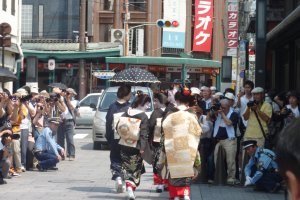 The crowd of photographers reaches its peak near Gion's most famous teahouse