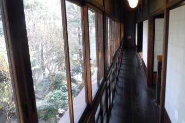 <p>Here is the hall running the length of the house, facing a small courtyard. The view through the old glass appears&nbsp;rippled, such is the quality of old glass.&nbsp;</p>