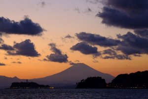 Mt. Fuji is not that close, BUT when the timing is right, her silhouette towers over you and fills the sky.