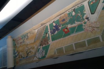 <p>A painted scroll spread out on display&nbsp;at the Kita City Asukayama Museum.</p>