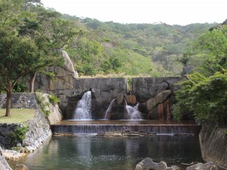 This mini man-made waterfall marks the end of the camping area and the beginning of the nature trail to Hiji Falls