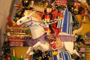Warrior riding Yamakasa Festival float.