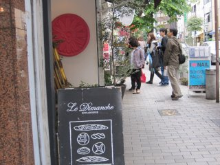 Find Le Dimanche bakery by looking forthe pretzel outside the store