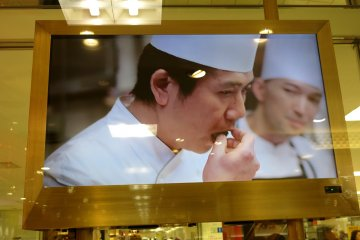 <p>Pastry Chef, Takagi Yasumasa of Le Patissier Takag<strong>i</strong> samples his KitKat creation</p>