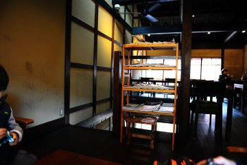 <p>The upstairs cafe space is cozy and open.</p>