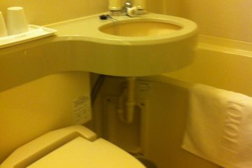 Bathroom with washlet and combined shower bath