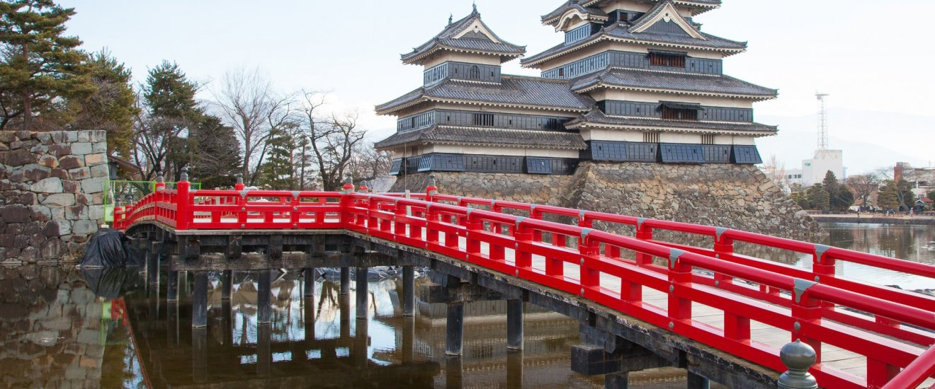 The beautiful red bridge of Matsumoto Castle.