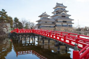The beautiful red bridge of Matsumoto Castle.
